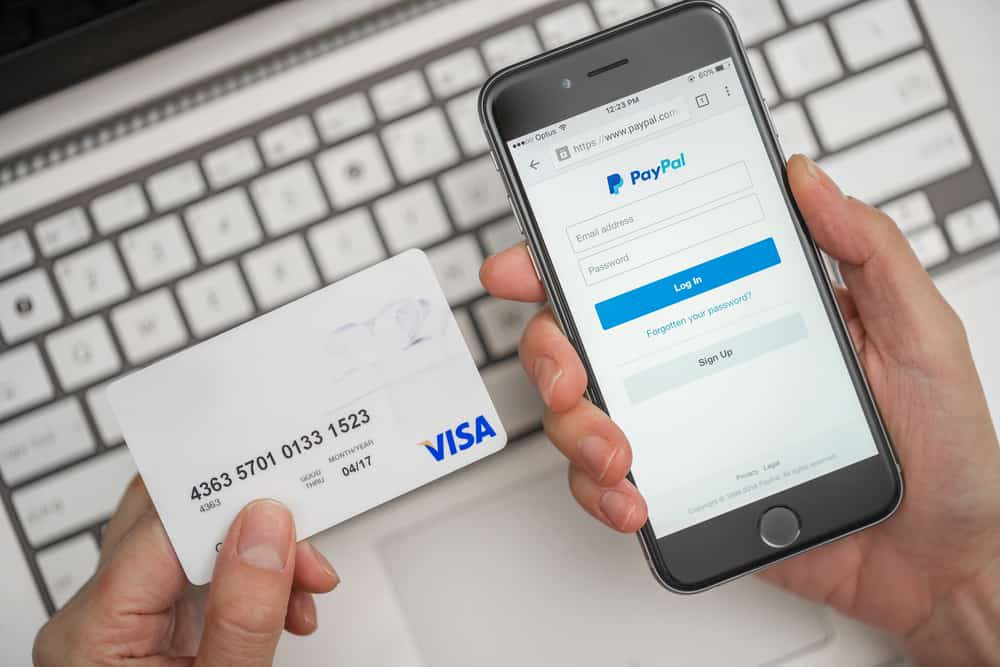 shopper using PayPal on their phone with a credit card