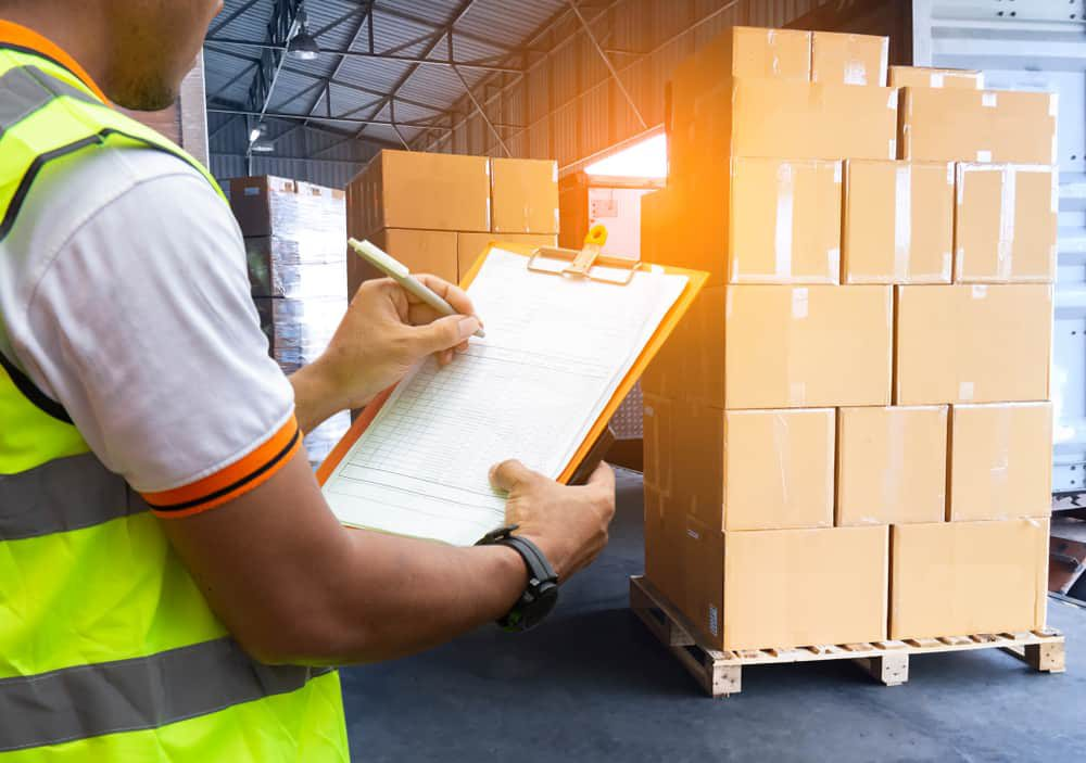 Shipping boxes and warehouse worker