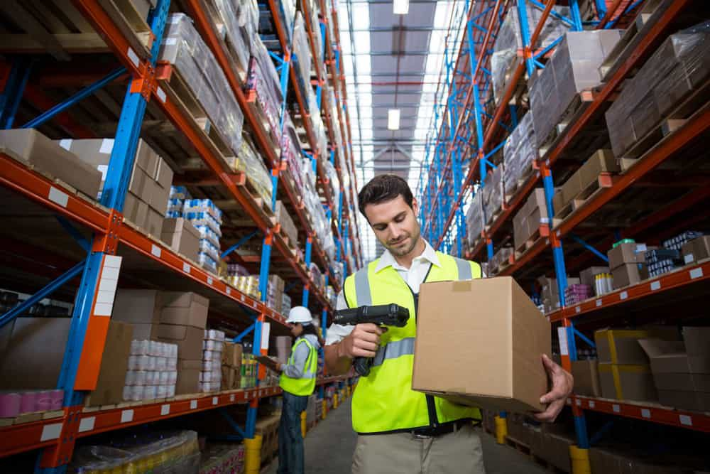 warehouse worker scanning box with rf wireless device