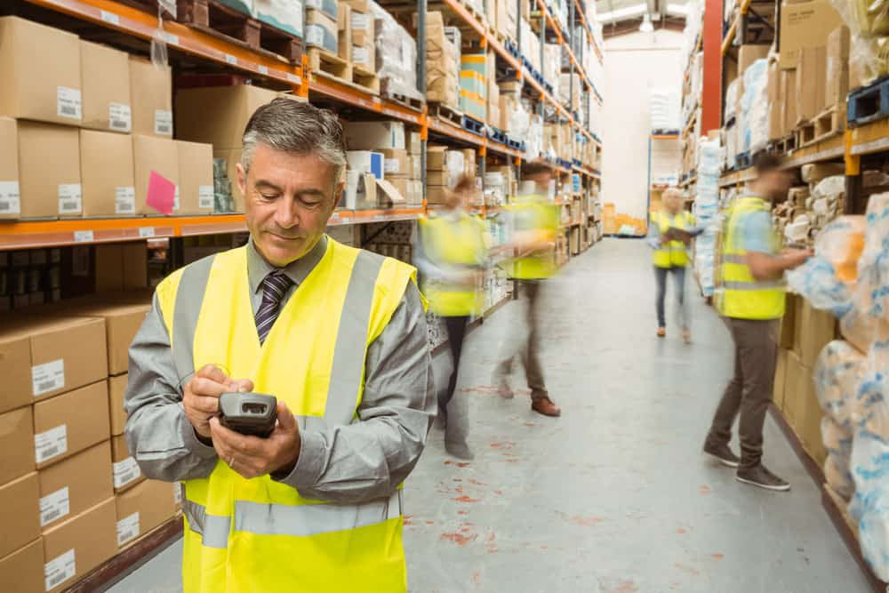 warehouse workers in large warehouse